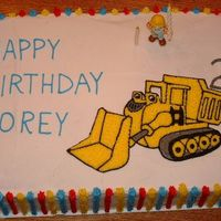 Dump Truck Cake This was my first attempt at a half sheet cake. Boy, it is a lot harder to do than a little 8 inch round! The BCT is MUCK from Bob the...