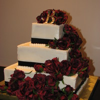 Black Ribbon/burgundy Roses My first square wedding cake. Fairly basic, white cake, black ribbon and the silk burgundy roses. She wanted an elegant look and I like the...