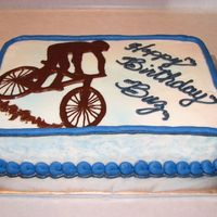 Mountain Bike Yellow cake w/ BC frosting. Mountain Biker done in melted chocolate.