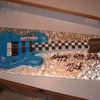 Electric Guitar Loved doing this cake for my Big Brother-just turned 40 and plays the guitar. Combo of carrot cake for the guitar body w/ cream cheese...
