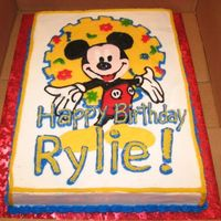 Mickey Mouse Cake 1/2 yellow, 1/2 choc. sheet cake. FBCT and BC frosting.