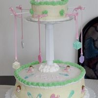 "Sleeping Baby Carousel This was my first paid cake. It was for my cousin's babyshower. I made a 12"" and a 6"" chocolate cake, covered in BC with..."