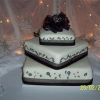 Wedding Cake Three tier wedding cake. Chocolate (mocha mousse), white (french vanilla mousse with chocolate shavings) chocolate (double choc. mousse /w...