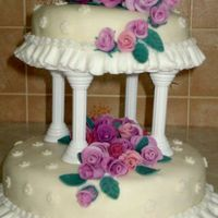 Two Tier Wedding Cake Chocolate cake with chocolate ganache. Covered in MMF with gumtex and 36 roses.