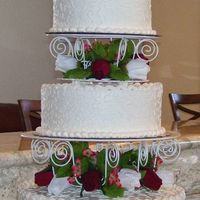 My First Wedding Cake This is a 14, 10, and 8 inch all butter cream with artificial roses. The 14 and 8 are vanilla with raspberry filling and the 10 is...