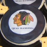Chicago Blackhawk Hockey Pucks Sugar cookies with buttercream and MMF.
