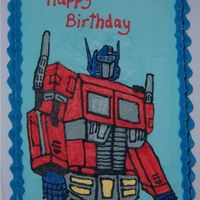 Optimus Prime Cake I've just finished my husband's birthday cake. He's a big transformers fan, so I went with Optimus Prime. I think his head...
