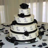 Black And White Wedding Cake I was very happy with this cake! My 3rd wedding cake and probably my best cake ever! It was for a coworker?s sister, 16?, 14?, 10?, and 6?...
