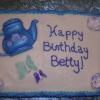 Tea Pot   Yellow Cake, Buttercream, with gumpaste accents and gelatin butterflies. For my Aunt who turned 90.