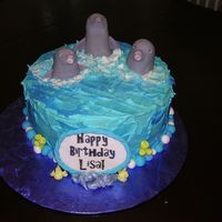 Lisa's Dolphins Darn Good Chocolate Cake with Peanut Butter Buttercream. RKT dolphins coverd with fondant. Icing plaque.