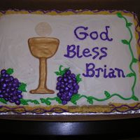 Brian's First Communion   Yellow Cake, chocolate chip cookie center with chocolate buttercream. Fondant accents.