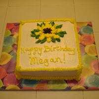 Sunflower Birthday Cake A lemon cake with buttercream icing. I tried making a sunflower but I think it needs work.
