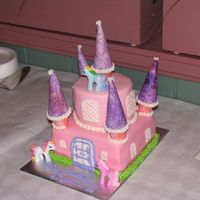 "Niece's Little Pony Castle Made for my niece's 6th birthday. Castle is a 3 layer 8"" devils' food cake square base w/ chocolate pudding and a 4 layer 6&..."