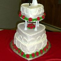 Heart Wedding Cake  This cake was chocolate and yellow. All decorated and filled with buttercream. This couple had been together for some time thus the fun...