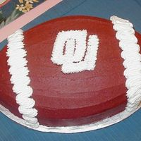 Ou Football Groom's Cake   This cake was done with the multi colored roses wedding cake. Her groom was an OU fan.