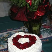 Angel Food Strawberry Valentine's Cake   Angel Food iced with fresh whipped cream topped with strawberries for Valentine's Day.