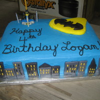 Batsignal Over Gotham City Buildings and signal were made out of MM fondant. This is one of my first times attempting script on a cake, so I had to redo several...