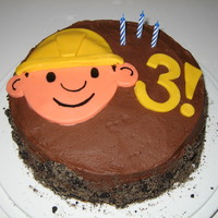 Bob The Builder Dirt Cake  Quickie cake for my son on his actual bday (he got a firetruck for the party :) ). Chocolate fudge cake with choc. BC, oreos and brown...