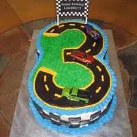 "Race Cars Cake Last minute birthday cake for my nephew ( I had less than 24 hours notice, and I'm no professional!) 2 8"" chocolate chip cakes..."