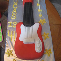 Electric Guitar Chocolate chip guitar cake. My first time working with MMF. I was really happy with how this turned out. I used embroidery thread for the...