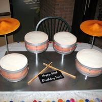 "Drum Set Cake This set is nearly full size to feed 100. 2 9"", 1 10"" and 1 12"" round cakes. The cymbals are dried gumpaste as are the..."
