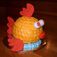 Fish Cake I copied a cake picture I saw here and added a few twists to it. I did this for a benefit for a friend.