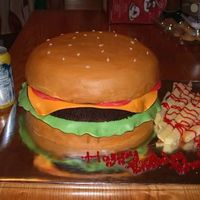 "Cheeseburger!! This was so much fun. Two 10"" round yellow cakes for the buns and 1 10"" round chocolate for the burger. I copied and meshed a few..."