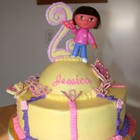 Dora Chocolate cake with chocolate filling, bc icing, and royal icing accents. Dora is a toy though.
