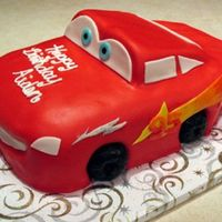 Just For Aiden My nephew is still in love with Cars so this was for his 3rd birthday. Sculpted out of smores cake and MMF details with donut tires!! He...