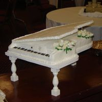 Baby Grand Piano   Buttercream w/fondant roses & calla lilies. Cake was 2'x3' and fed 200.