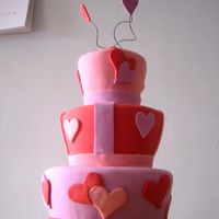 Romantic Wedding / Valentine's Day Cake Fondant covered romantic wedding cake with tapered tiers.