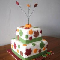 Fall-Themed Shower Cake A fondant-covered cake for a wedding shower that happened around Thanksgiving. Leave are also fondant.