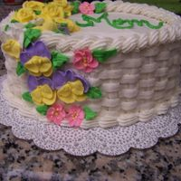 Mother's Day Cake Ii Another basketweave!Royal icing flowers, buttercream frosting, and cjocolate cake with blackberry filling.