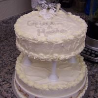 Gina's Brida Shower Cake  Made this cake for my cousin's bridal shower tomorrow. It is a white cake with bavarian cream filling, buttercream frosting and royal...