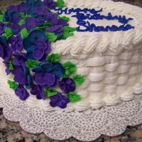 Shannon's B-Day Cake Ii   I love basketweave (lol)!Royal Icing Flowers, buttercream frosting and chcolate cake.