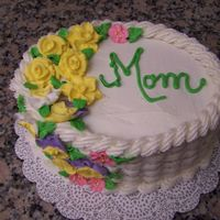 Mother's Day Cake I Another basketweave!Royal icing flowers, buttercream frosting, and cjocolate cake with blackberry filling.