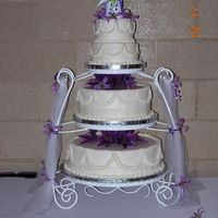 "Pearls And Ruffles This was my first wedding cake - the bottom is a double layer 16"" round, the center is a double layer 12"" round (and we had one..."