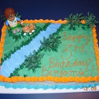Happy Birthday Benjamin! For a special 3-year old boy. Diego, Baby Jaguar, and the trees were plastic, everything else is buttercream.