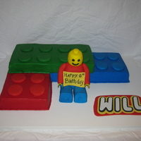 Lego Cake Buttercream icing. RKT lego man covered in fondant. Used Cricut for letters - love it!!