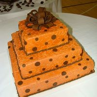 Terracotta Orange And Brown 16, 12, 4 all buttercream with fondant polka dots and bow. Had a bit of an accident while moving it (thanks to husband), but you coudn&#039...