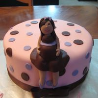 Preggo Chick hand molded figure on fondant covered cake