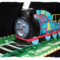 Thomas Train Cake This was a 3d thomas cake I did for a friends sons 2nd birthday. Wish I could put on the photo of his face, he loved it.