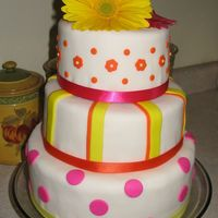 Allison  This is MY wedding cake, made to match my favorite flower, Gerbera daisies. 10-8-6 tiers. I had a few fondant issues, but was fairly...