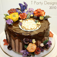 Chocolate Ganache Sugar Flower Cake This cake was Chocolate Heaven! Choc cake, with CG buttercream & CG glaze on top. All flowers are made of gumpaste.