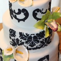 Damask Wedding Cake Oh, this was a fun one. Draped in fondant with royal icing damask stencil, the top layer is flour less chocolate cake for the bride, Lemon...