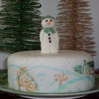 The Snowman  Inspired by the beloved children's story, and my husband's favorite. Christmas cake covered in marzipan and fondant, then painted...