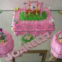 Hello Kitty Birthday Cake This was a Birthday cake for my niece. The swing is not a cake topper, it is actually a glue dispenser that I used on top of the...