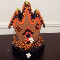 Halloween Cake Wilton's gingerbread house on top of a cake.