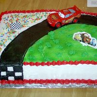 Lightning Mcqueen I made this cake today for my son's 7th birthday (tomorrow). 11 X 15 white cake with lemon filling. Airbrushed road and grass. Piped...