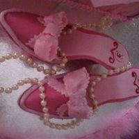 Pink Shoes Here is an up close pic of my 1st attempt at gumpaste shoes! I was happy with the outcome except for the Wilton luster dust I used on the...
